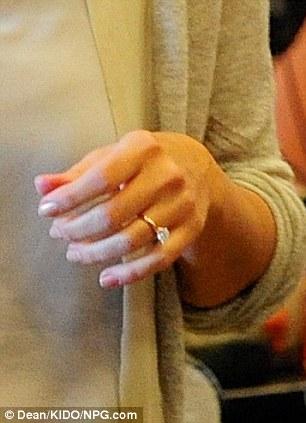 No wonder she said yes! The 27-year-old flashed her amazing platinum sparkler