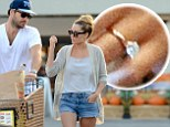 Something to celebrate! Lauren Conrad flashes her stunning engagement ring as she and fiancé William Tell stock up on party supplies