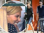 Who's that guy? Charlize Theron looks giddy with happiness during lunch date with mystery man