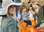 Say boo! Ali Larter makes memories as she snaps her son Teddy perching on a pumpkin as they head to celebrity favourite Mr. Bones Patch