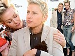 Getting in some practice? Ellen DeGeneres and Portia de Rossi enjoy some puppy love