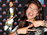Still a kid at heart! Zendaya Coleman can not help but pull funny faces as she poses in a high fashion look