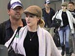 Ryan Reynolds and wife Blake Lively are a co-ordinating couple as they jet into New Orleans in casual caps