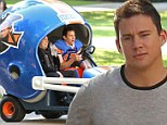 Having a super ball! Channing Tatum and Jonah Hill drive around in giant football helmet on set of 22 Jump Street