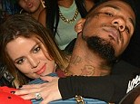 Getting cosy: Khloe Kardashian parties with The Game last Friday at the birthday celebration for DJ Mark Da Spot