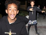 Jaden Smith dances playfully in the middle of the street as he shows off his quirky fashion sense in a skirt