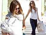 Need some help? Kate Beckinsale teeters down stairs in heels while carrying large bag