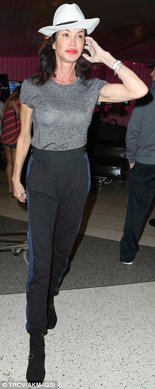 All eyes on me: Janice Dickinson strutted through LAX after disembarking a flight from Paris