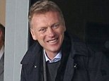 All smiles: Manchester United manager David Moyes (third right) acknowledges a spectator during Fleetwood's 1-1 draw with Chesterfield at the Highbury Stadium