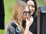 Tucking in: Cara Delevingne was seen enjoying a greasy McDonald's on the set of her DKNY shoot in New York on Tuesday