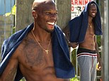 Shirtless Chad Johnson puts his muscly chest on display to film scenes for gritty new film Overtown