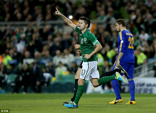 Robbie Keane celebrates after equalising Kazakhstan's opener with a penalty