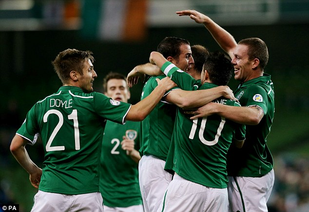 Ireland teammates celebrate with John O'Shea after he scores their second