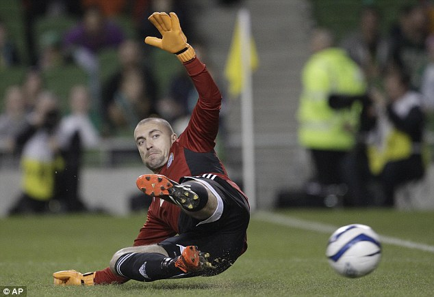 In glove and war: Kazakhstan's goalkeeper Andrey Sidelinikov had a busy night in goal