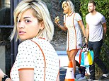 Click your heels together three times: Rita Ora dons short dress and trainers with wings to catch flight with Calvin Harris