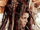 Hiding out in the forest! Kendall Jenner shares a snap from another risque photo shoot...at the ripe age of 17