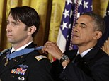 U.S. President Barack Obama (R) awards William Swenson, a former active duty Army Captain, the Medal of Honor for conspicuous gallantry