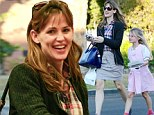 What's not to smile about? Jennifer Garner is even excited about paying for groceries as she grins her way through the day