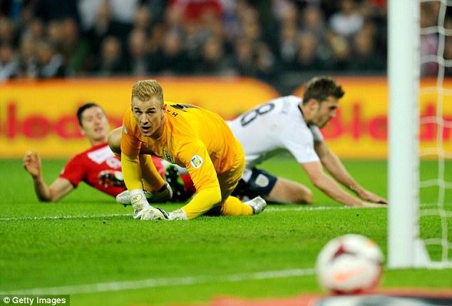 Relief: England keeper Joe Hart watches on as Lewandowski's effort goes past the post