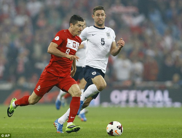 Handful: Three Lions defender Gary Cahill chases down the Borussia Dortmund forward