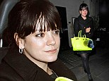 Mum's night off: Lily Allen smiles away as she enjoys a night out in London