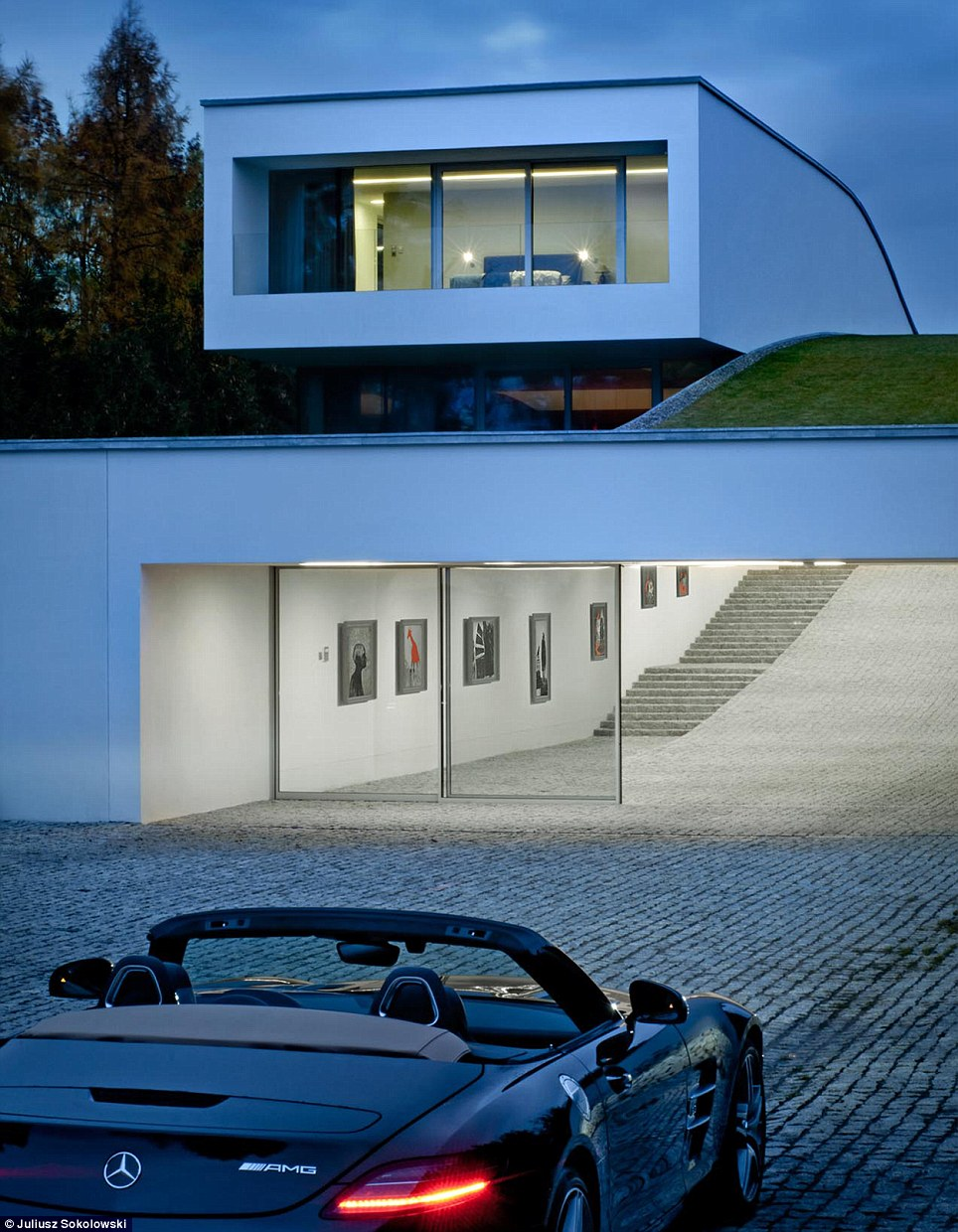 Split level: The mystery owner is able to drive up to front of the house, open a set of automatic gates and then cruise through the tunnel admiring their stunning collection as they go