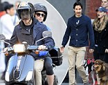 Romantic ride: Justin Long drove a Vespa with girlfriend Amanda Seyfried in the rear on Tuesday in New York City
