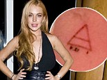 'Feeling good and love you': Lindsay Lohan offers fans a glimpse of her new tattoo centered around 'love, power and truth'