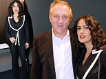 Parisian chic! Salma Hayek dons stylish black and white Alexander McQueen suit at photography exhibition in her adopted homeland