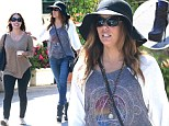 She gets by with a little help from her friends! Eva Longoria steadies herself with pal's shoulder as she teeters along in killer platform boots