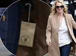 Britney Spears out and about in London wearing a badge coat