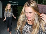Molly Sims flashes bra in sheer leopard print top before tottering over the gravel in red heels after dining with hubby Scott Stuber