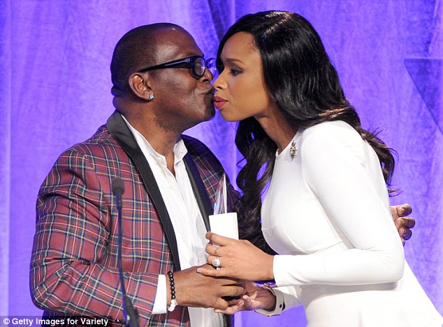 You're welcome: Randy Jackson presented the Dreamgirls star with her award... and a sneaky kiss
