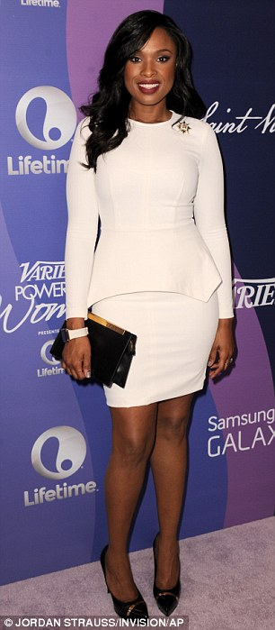 She's a knockout: The 32-year-old singer and actress was stunning in a white form-fitting dress