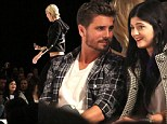 Model flashes middle finger in direction of Kylie Jenner and Scott Disick as they chat together at fashion show