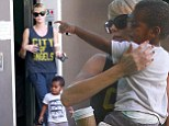 He's her number one! Charlize Theron scoops son Jackson up into her arms as they enjoy a day of bonding after actress lunches with mystery man