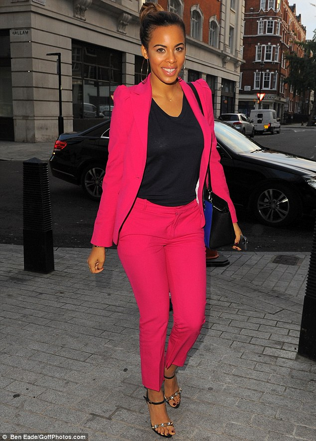 The future's bright: The 24-year-old singer showed off her style credentials by injecting a pop of colour to the chilly autumnal morning in a fun fuchsia trouser suit, made up of a tailored blazer jacket and chic cigarette pants