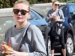 Super slim Kirsten Dunst quenches her thirst with a healthy juice after sweaty workout at the gym
