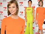 Karlie Kloss, left, rocked a neon orange dress, while Olivia Munn opted for electric yellow on Wednesday at a fundraising event in New York City