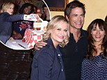 Cream of the crop! Amy Poehler squirts on cake at Parks and Recreation 100th episode party with Rob Lowe and Rashida Jones