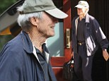 A fistful of luggage! Clint Eastwood, 83, carries his own suitcase as he leaves New York hotel