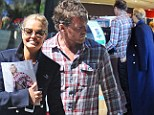 Russhing into things? Lara Bingle can't resist some shameless self-promotion as she and new beau Sam Worthington slip into a domestic routine