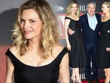 Tight cast: Michelle Pfeiffer, Robert De Niro and Dianna Agron huddled up on Wednesday at the premiere of their new film The Family in Roissy, France