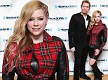 Better luck next time... Avril Lavigne wore a bizarre tartan-and-leather peplum jacket as she and her husband Chad Kroeger visited SiriusXM Studios in New York City on Tuesday