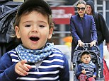 Stars and stripes! Miranda Kerr dresses her son Flynn in a snappy mix of prints as she teaches him the art of window shopping on swanky Madison Avenue