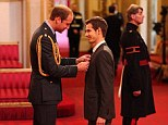 Award: Wimbledon champion Andy Murray smiles as he receives his OBE medal from the Duke of Cambridge, during his first investiture ceremony