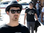 Joe Jonas steps out for lunch amid rumours that his 'secret drug addiction' was the 'real reason' for cancelling the Jonas Brothers' tour