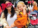 Bethenny Frankel's daughter dresses up as a butterfly while the chat show host gets involved with an elaborate eye mask