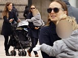Natalie Portman introduces son Aleph to the Parisian culture as she holds him close on their walk to the Tuileries Garden