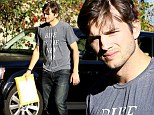 Environmentally-conscious Ashton Kutcher steps out in 'bike is the new car' T-shirt after being named TV's highest-paid actor